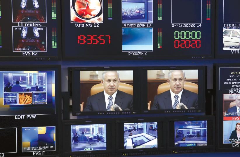 Media screens from Israeli media show Prime Minister Benjamin Netanyahu. (photo credit: REUTERS)