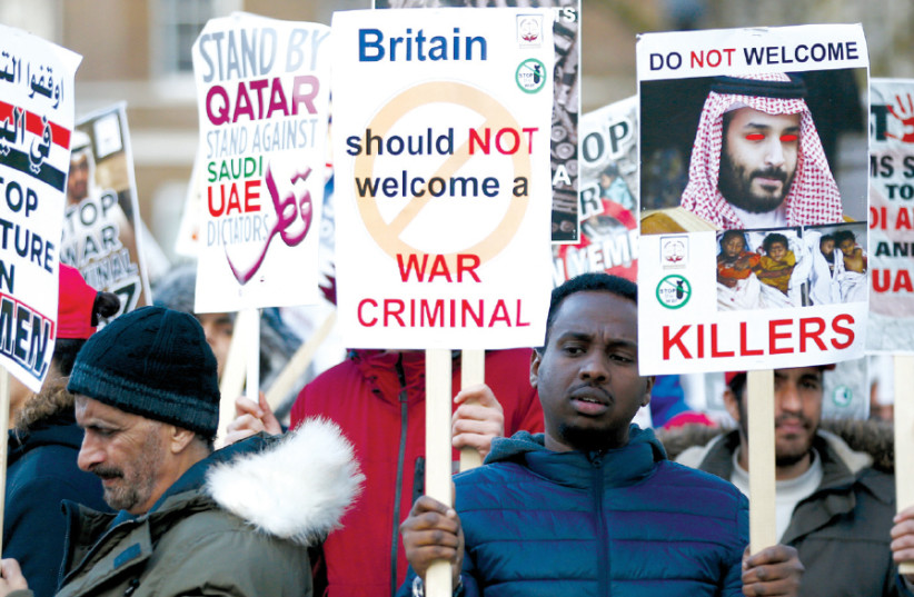 PROTESTERS WAVE placards opposite Downing Street before Saudi Crown Prince Mohammad bin Salman visits Britain's Prime Minister Theresa May in London, last week (photo credit: HENRY NICHOLLS/REUTERS)
