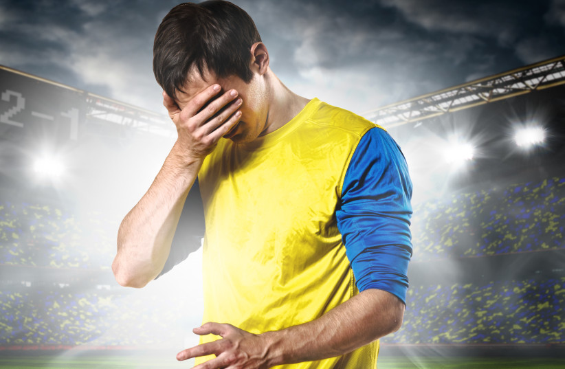 Illustrative photo of a soccer player hiding his face (photo credit: INGIMAGE)
