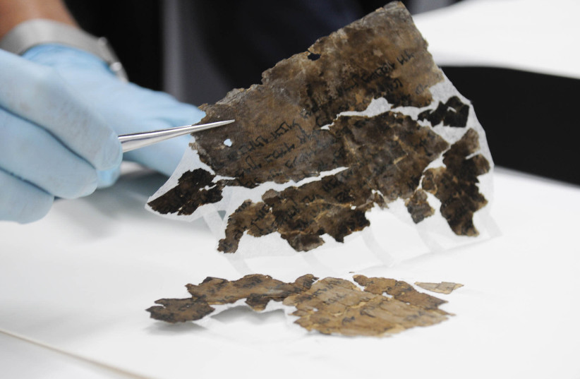 Conserving the Dead Sea Scrolls at the Israel Antiquities Authority laboratories in Jerusalem (photo credit: SHAI HALEVI / ISRAEL ANTIQUITIES AUTHORITY)