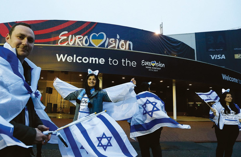 Israeli fans wave flags before last year's Eurovision Song Contest Grand Final at the International Exhibition Center in Kiev, Ukraine (photo credit: REUTERS/VALENTYN OGIRENKO)