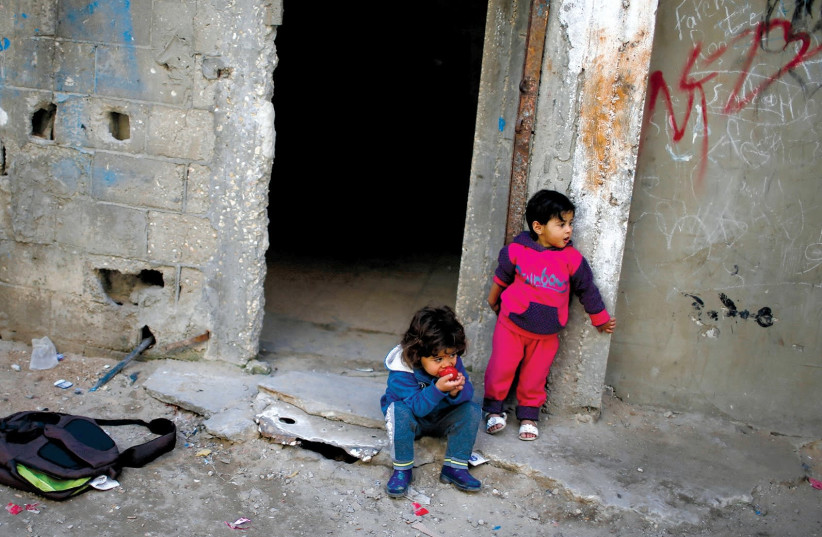 IMPOVERISHED CHILDREN in Gaza City's Shati refugee camp. (photo credit: MOHAMMED SALEM/REUTERS)