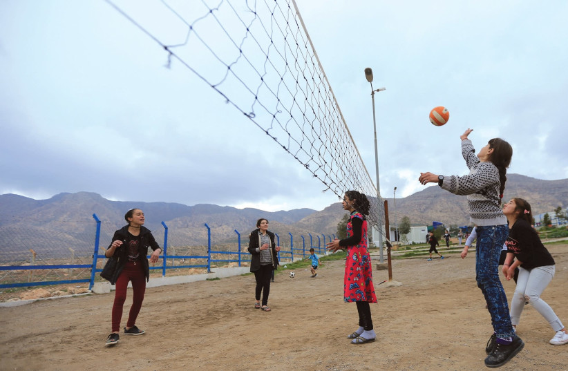 YAZIDI STUDENTS play last month near the psychotherapy center in the Rawanga camp in Iraq. (photo credit: REUTERS)