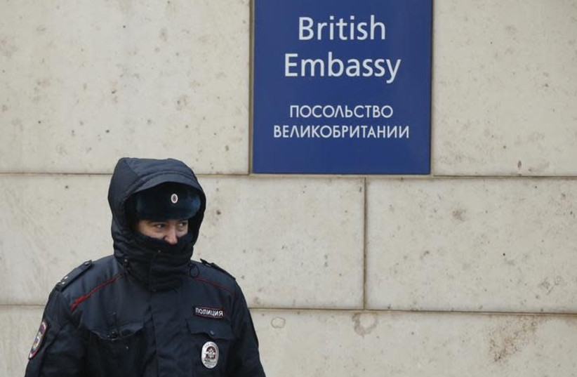 A Russian policeman walks outside the British embassy in Moscow, Russia, March 17, 2018 (photo credit: DAVID MDZINARISHVILI/REUTERS)