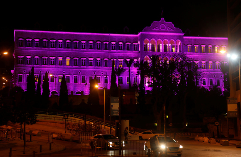 Lebanon's government palace is seen illuminated purple to mark International Women's Day in downtown Beirut, Lebanon March 7, 2017.  (photo credit: MOHAMED AZAKIR / REUTERS)