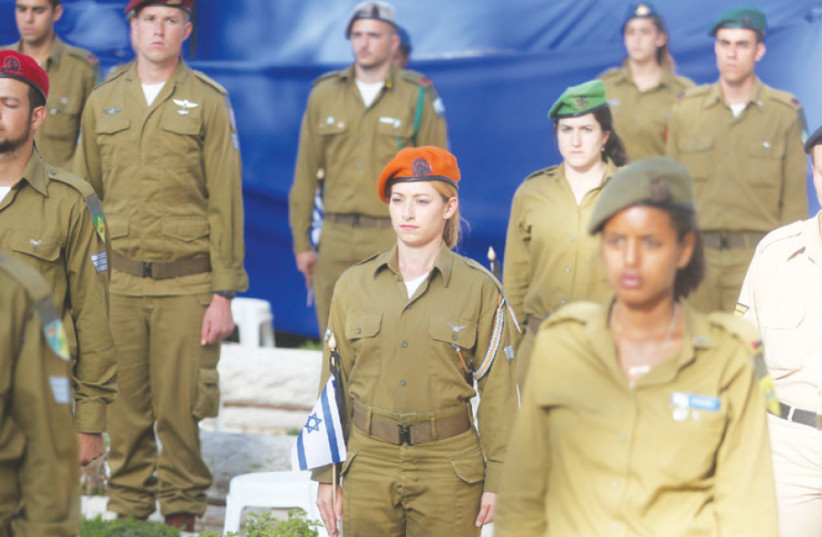 Male and female soldiers remember the fallen at a Remembrance Day ceremony on Jerusalem's Mount Herzl (photo credit: MARC ISRAEL SELLEM)
