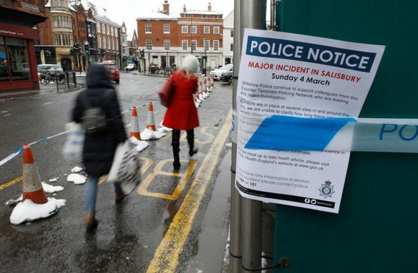 A police notice is attached to screening surrounding a restaurant which was visited by former Russian intelligence officer Sergei Skripal and his daughter Yulia before they were found on a park bench after being poisoned in Salisbury, Britain, March 19, 2018 (photo credit: REUTERS/PETER NICHOLLS)