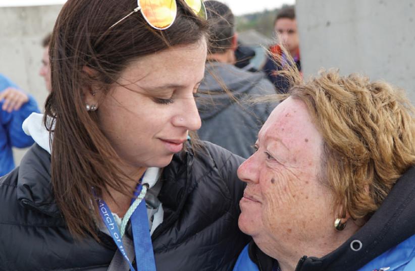 MICHELLE EKSTEIN comforts her grandmother, Anita Ekstein  (photo credit: MICHELLE EKSTEIN)
