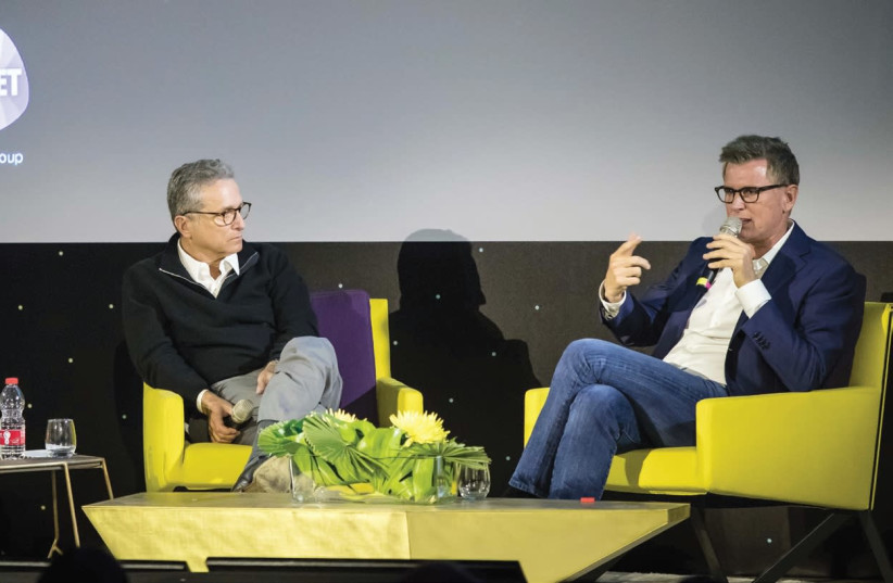 SUPER-AGENT Rick Rosen (left) and TBS/TNT president Kevin Reilly take the stage at the INTV Conference (photo credit: ODED CARNI)