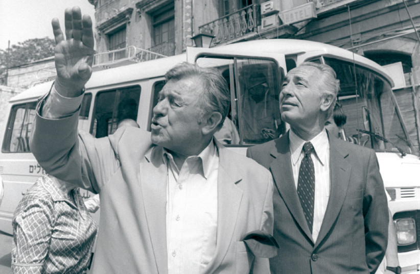 JERUSALEM MAYOR Teddy Kollek (left) points out special landmarks to then-prime minister Shimon Peres during a walking tour of Jerusalem in 1985 (photo credit: HERMAN CHANANIA/GPO)