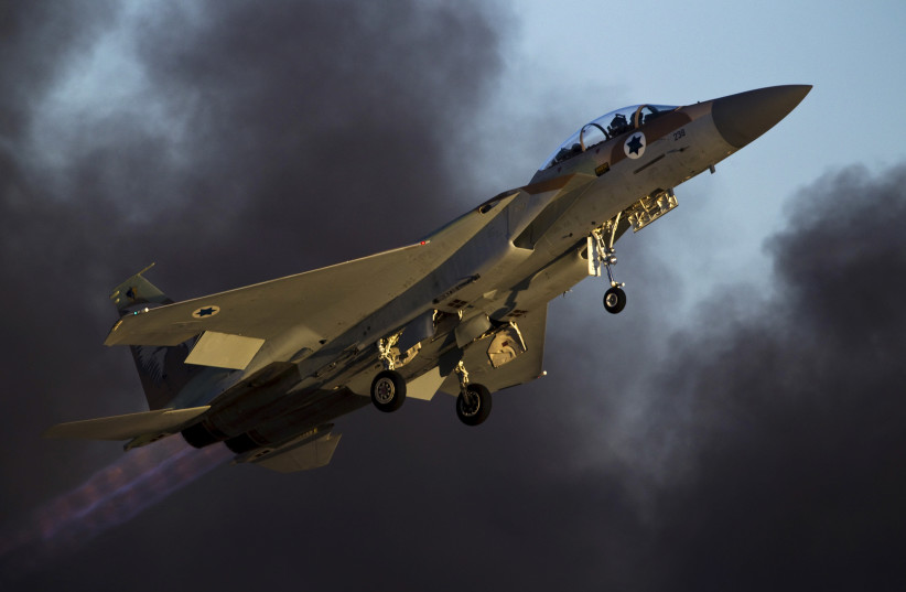 An Israeli air force F-15 fighter jet flies during an exhibition as part of the graduation ceremony of air force pilots at Hatzerim air base in southern Israel (photo credit: AMIR COHEN/REUTERS)