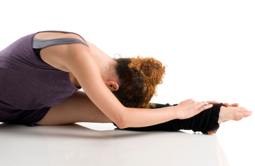 A dancer stretches (photo credit: INGIMAGE)