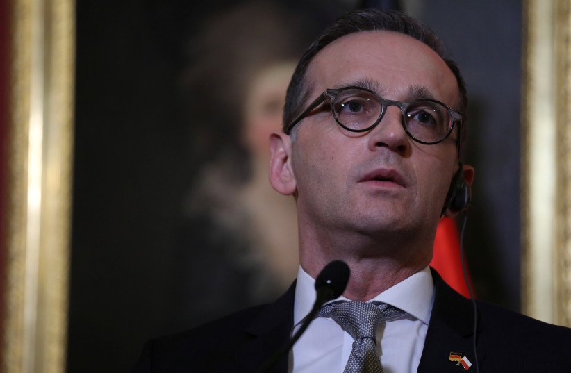 German Foreign Minister Heiko Maas attends a meeting with his Polish counterpart Jacek Czaputowicz (not pictured) during his visit in Warsaw Poland, March 16, 2018 (photo credit: REUTERS)