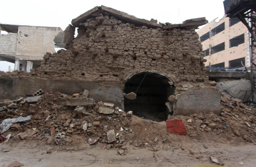 A damaged synagogue is seen in the Damascus suburb of Jobar December 14, 2014. The shrine and synagogue of prophet Eliahou Hanabi, dates back to 720 B.C. (photo credit: REUTERS/MOHAMMED BADRA)