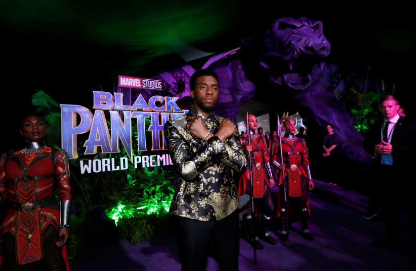 "Cast member Chadwick Boseman poses at the premiere of ""Black Panther"" in Los Angeles, California, January 29, 2018. (photo credit: MARIO ANZUONI/REUTERS)"