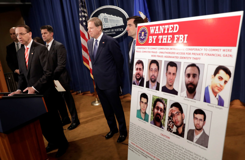 U.S. Deputy Attorney General Rod Rosenstein speaks at a news conference with other law enforcement officials at the Justice Department to announce nine Iranians charged with conducting massive cyber theft campaign, in Washington, U.S., March 23, 2018. (photo credit: REUTERS/YURI GRIPAS)