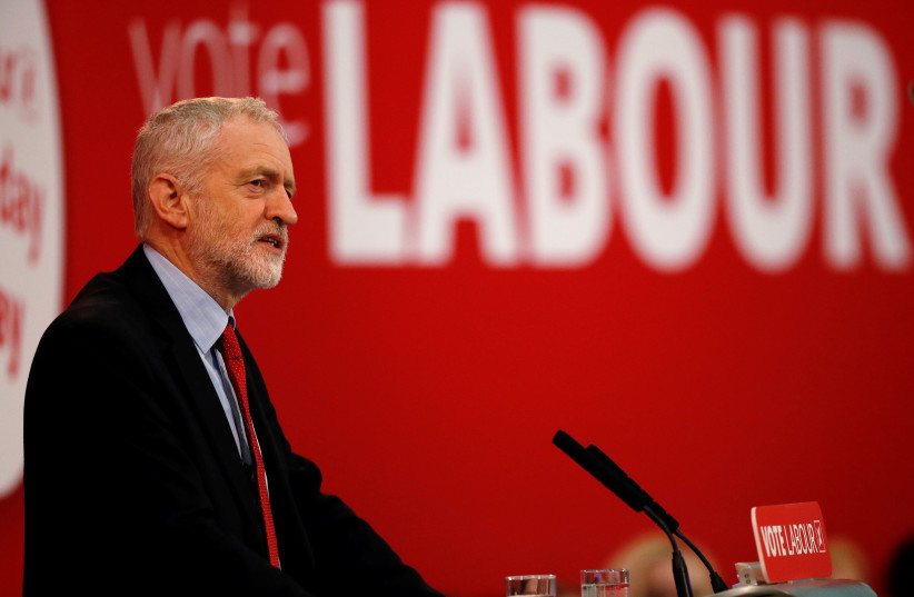 The leader of Britain's opposition Labour Party, Jeremy Corbyn, delivers a speech in Manchester, Britain, March 22, 2018. (photo credit: REUTERS/PHIL NOBLE)