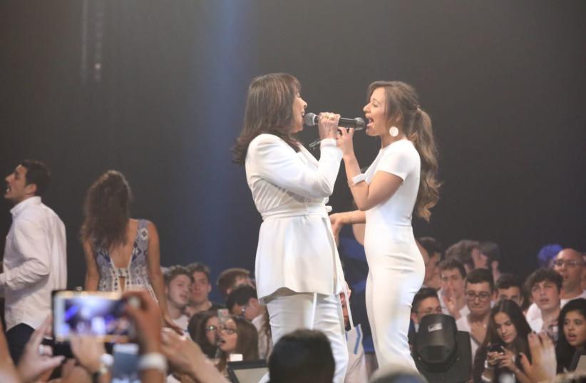 "Gali Atari (L) and Eden Ben-Zaken (R) duet the classic song ""Hallelujah"". (photo credit: RAFI DELOUYA)"