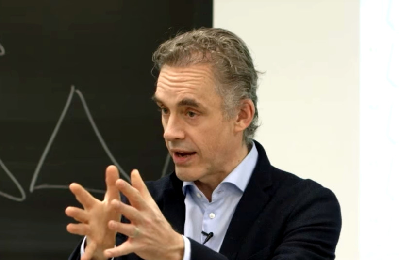 Jordan Peterson delivering a lecture at the University of Toronto in 2017 (photo credit: ADAM JACOBS)