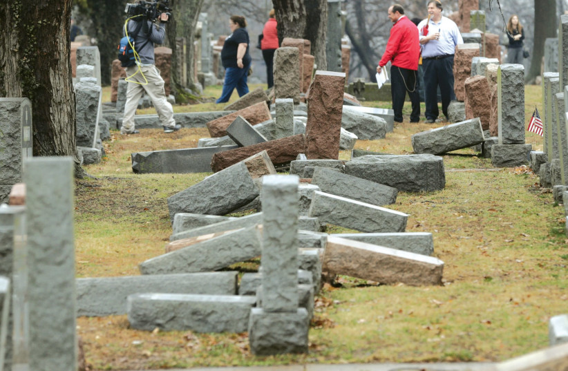 Grave stones tipped over after a antisemitic attack in the US (photo credit: REUTERS)
