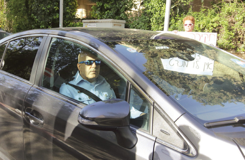 Police Inspector arrives at Prime Minister Benjamin Netanyahu's official residence in Jerusalem yesterday to question him in connection with Case 4000. (photo credit: MARC ISRAEL SELLEM/THE JERUSALEM POST)