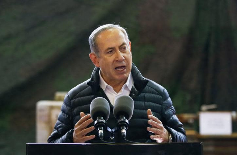 Israeli Prime Minister Benjamin Netanyahu speaks during a visit of an army base in the West Bank settlement of Beit El near Ramallah January 10, 2017 (photo credit: BAZ RATNER/REUTERS)