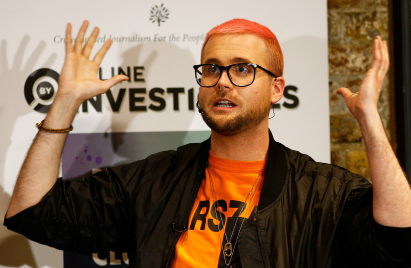 Christopher Wylie, a whistleblower who formerly worked with Cambridge Analytica, at the Frontline Club in London, Britain (photo credit: HENRY NICHOLLS/REUTERS)