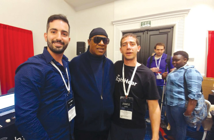 Stevie Wonder visits with Israeli start-up RightHear at a convention in California (photo credit: Courtesy)