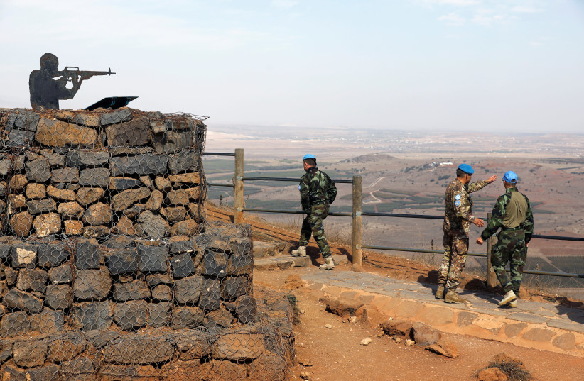 U.N. peacekeepers patrol Mount Bental, an observation post in the Golan Heights near the ceasefire line between Israel and Syria October 23, 2017.  (photo credit: REUTERS/AMIR COHEN)