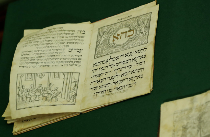 The Passover Hagada from the Guenzburg collection of ancient Hebrew manuscripts and books is pictured at the Russian State Library in Moscow, Russia November 7, 2017.  (photo credit: TATYANA MAKEYEVA/ REUTERS)