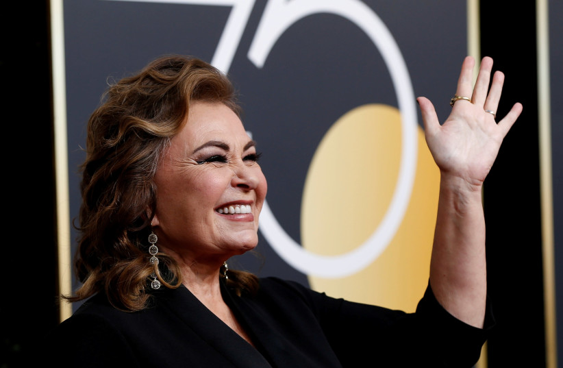 Actress Roseanne Barr reacts as she arrives at the 75th Golden Globe Awards in Beverly Hills, California, U.S., January 7, 2018.  (photo credit: MARIO ANZUONI/REUTERS)
