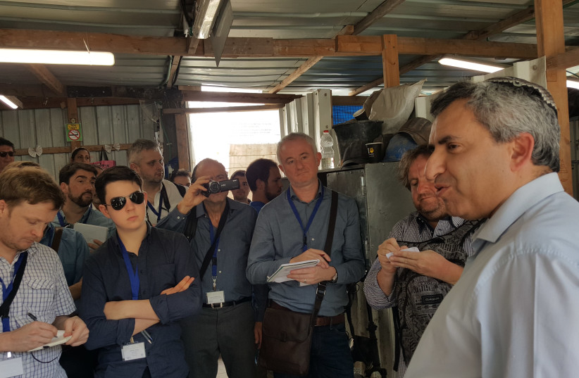Ze'ev Elkin, Jerusalem affairs minister (right), speaks to a group of European journalists during a recent tour of the City of David (photo credit: Courtesy)