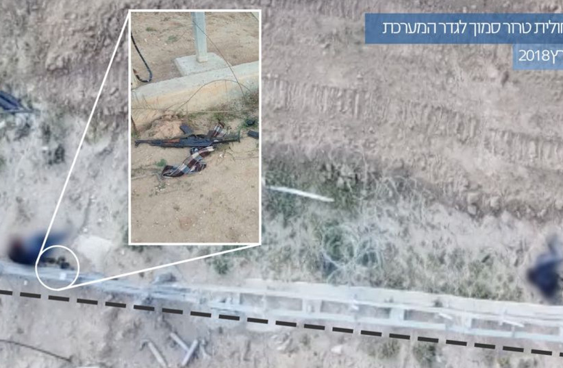 Weapons found by the border fence, the Hebrew caption says foiling a terrorist squad near the security fence March 30 2018    (photo credit: IDF SPOKESMAN'S UNIT)
