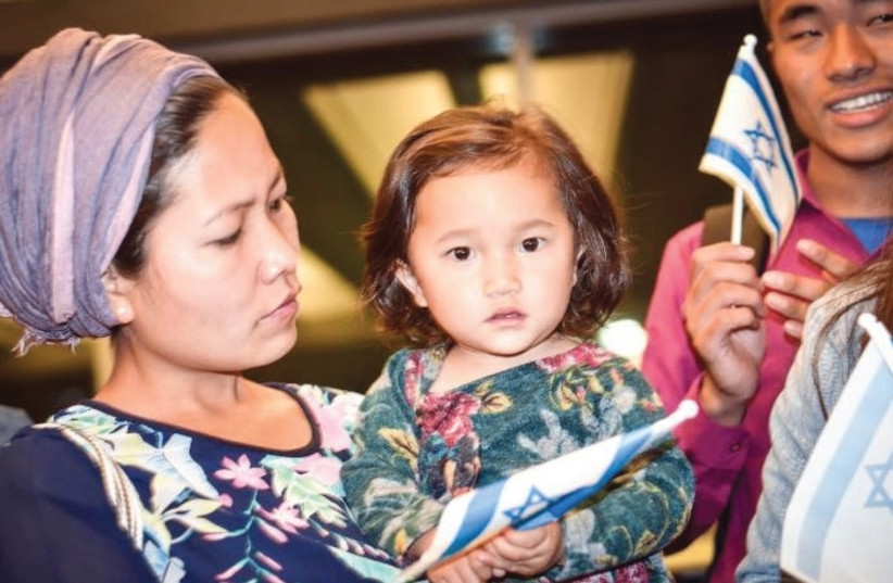 NURIT HAOKIP and her 18-month-old daughter Revital celebrate at Ben-Gurion Airport after making aliya this week from India. (photo credit: LAURA BEN-DAVID/SHAVEI ISRAEL)