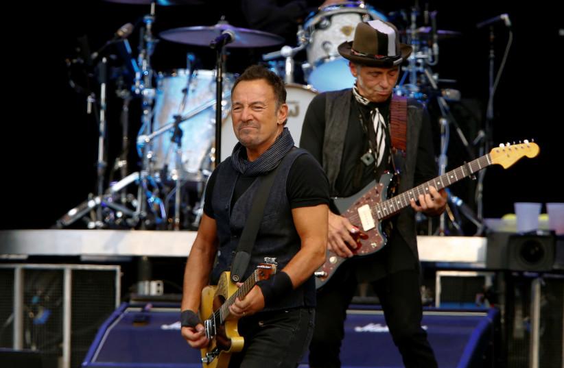"U.S. musician Bruce Springsteen (L) performs with guitarist Nils Lofgren on his ""The River Tour 2016"" at the Letzigrund stadium in Zurich, Switzerland July 31, 2016. (photo credit: ARND WIEGMANN / REUTERS)"