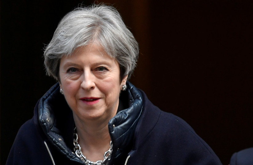Britain's Prime Minister, Theresa May, leaves 10 Downing Street, in central London, Britain March 21, 2018. (photo credit: REUTERS/TOBY MELVILLE)