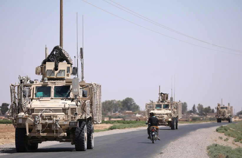 A US military convoy is seen on the main road in Raqqa, Syria July 31, 2017. (photo credit: REUTERS/RODI SAID)
