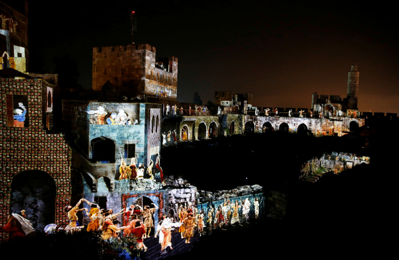 "The citadel walls of the Tower of David Museum are illuminated during the ""King David"" light and sound show, in Jerusalem's Old City (photo credit: AMMAR AWAD/REUTERS)"