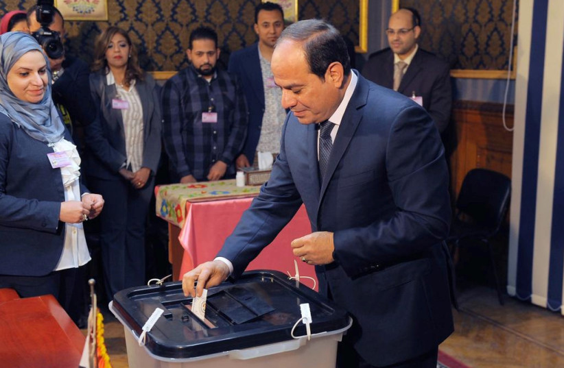 Egyptian President Abdel Fattah al-Sisi casts his vote during the presidential election in Cairo, Egypt March 26, 2018 (photo credit: THE EGYPTIAN PRESIDENCY/HANDOUT VIA REUTERS)