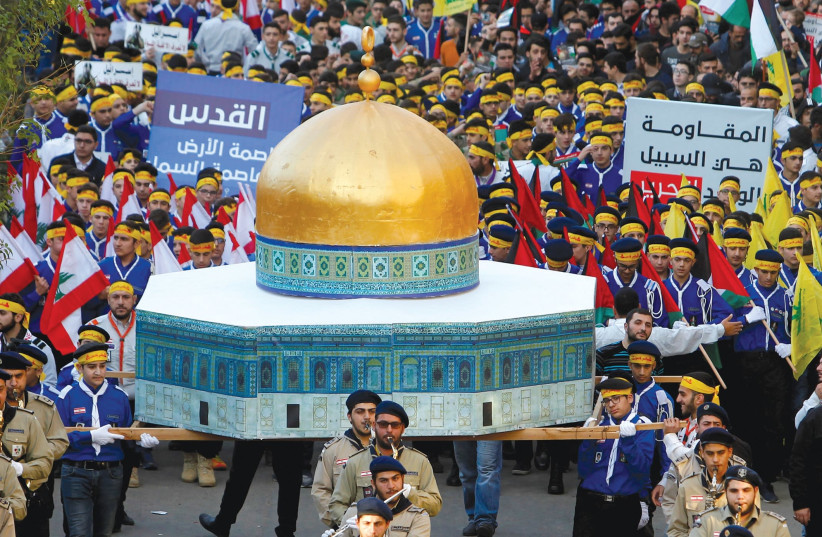 HEZBOLLAH SUPPORTERS carry a model of the Dome of the Rock during a rally in Beirut. (photo credit: REUTERS)