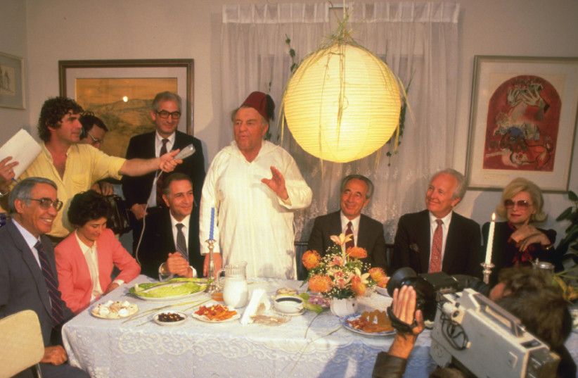 Legendary Jerusalem mayor Teddy Kollek hosts a post-Passover Mimouna celebration in his home, together with prime minister Shimon Peres and US consul-general Morris Draper, in 1986 (photo credit: NATI HARNIK/GPO)
