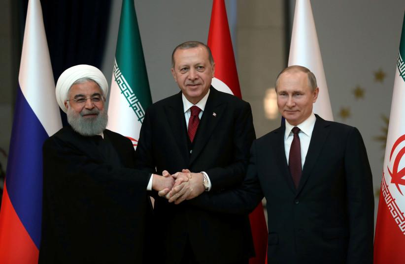 Presidents Hassan Rouhani of Iran, Tayyip Erdogan of Turkey and Vladimir Putin of Russia pose before their meeting in Ankara, Turkey April 4, 2018 (photo credit: TOLGA BOZOGLU/POOL VIA REUTERS)