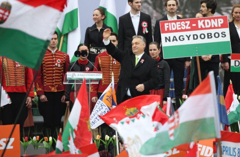 Hungary's Prime Minister Viktor Orban speaks during Hungary's National Day celebrations in Budapest (photo credit: MARKO DJURICA / REUTERS)