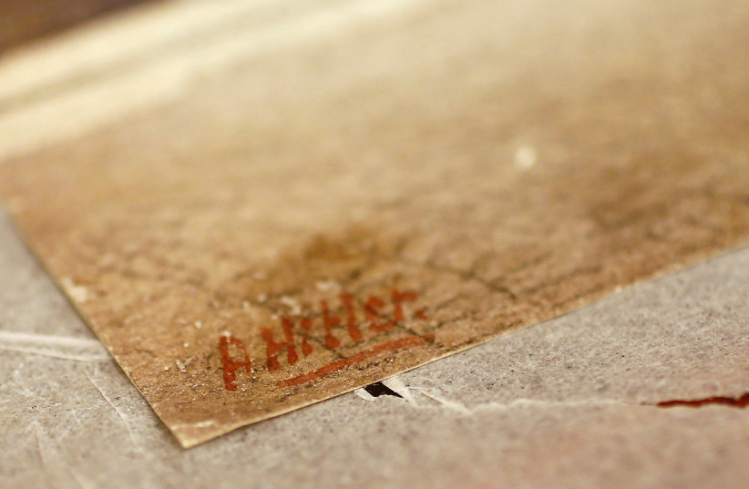 Hitler's signature on the corner of an oil painting at the Weidler auction house (photo credit: REUTERS/KAI PFAFFENBACH)