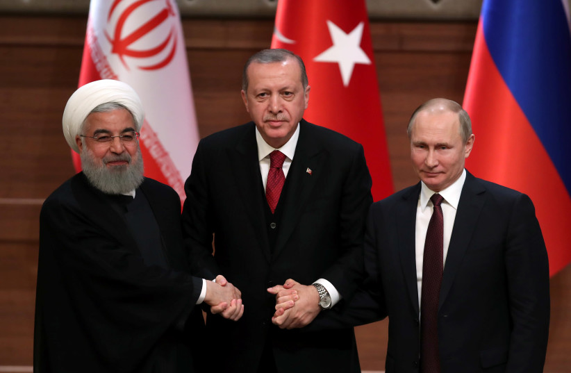 Presidents Hassan Rouhani of Iran, Tayyip Erdogan of Turkey and Vladimir Putin of Russia hold a joint news conference after their meeting in Ankara, Turkey April 4, 2018 (photo credit: UMIT BEKTAS / REUTERS)