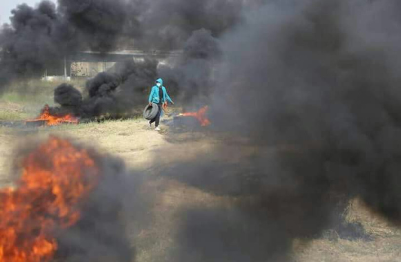 Palestinian protester burning tires  (photo credit: MAARIV)