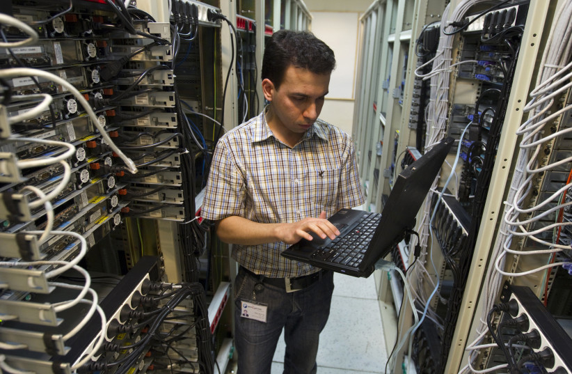 A computer engineer checks equipment at an internet service provider in Tehran February 15, 2011 (photo credit: CAREN FIROUZ / REUTERS)