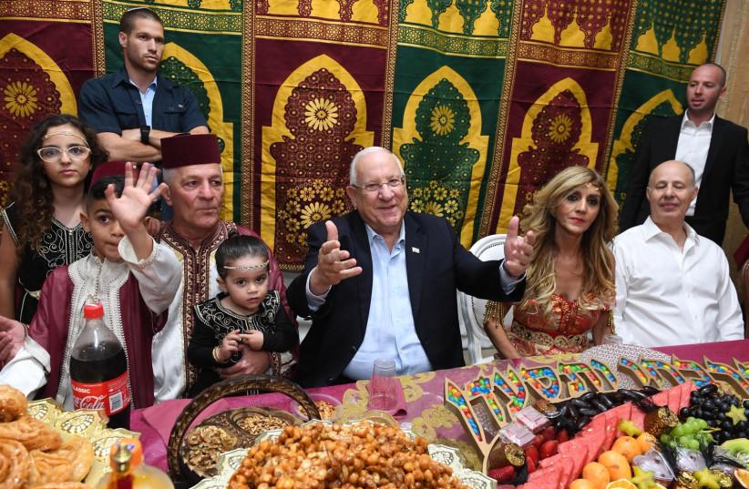 President Reuven Rivlin at a Mimouna celebration in Ashkelon, April 2018 (photo credit: MARK NEIMAN)