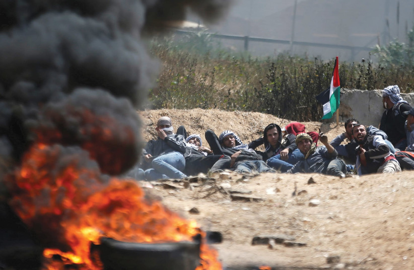 PALESTINIANS ATTEND a massive protest in Gaza on Friday. (photo credit: REUTERS)