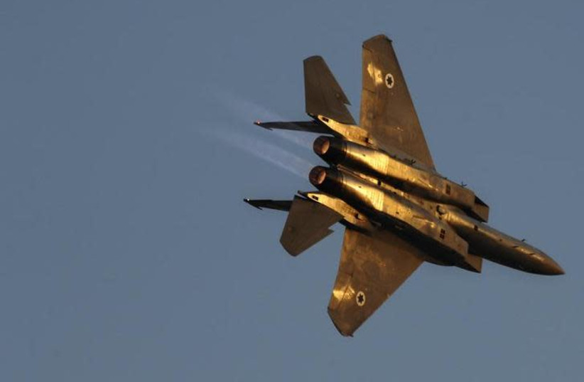 An Israeli air force F15 fighter jet flies during an exhibition as part of a pilot graduation ceremony at the Hatzerim air base, southern Israel June 25, 2009 (photo credit: AMIR COHEN/REUTERS)